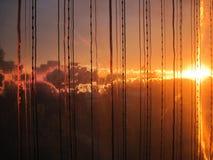 brännhet solnedgång Fotografering för Bildbyråer