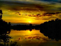 brännhet solnedgång Arkivfoton