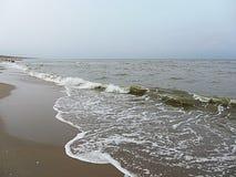 Bränning skum av för havet, hav Nederländerna Royaltyfri Bild