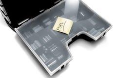 Bränsletryck på den klibbiga för anmärkning batteribehållaren över Arkivfoton