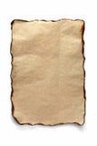Bränt ark av pergament arkivfoton