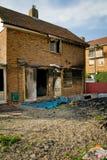 bränt brandhus Arkivfoto