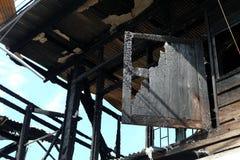 Bränt hus för slut upp Arkivbild