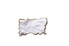 Bränt pappers- som isoleras på vit bakgrund fotografering för bildbyråer