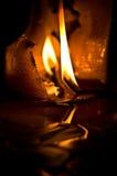 bränt stearinljus Arkivfoto