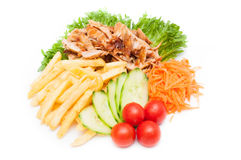 Brät Kartoffeln mit Hühnernuggets Lizenzfreies Stockfoto