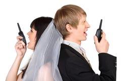Bräutigam- und Brautruf auf Funk trennte Stockfoto