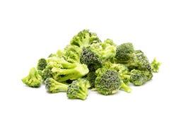 Brócolis congelados em um fundo branco fotos de stock royalty free