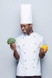 Brócolis ou pimenta? Foto de Stock Royalty Free