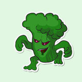Brócolis perigosos do vegetal do monstro Vegetal perigoso do monstro - brócolis com olhos vermelhos Foto de Stock