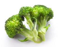 Bróculi fresco en blanco Imagen de archivo
