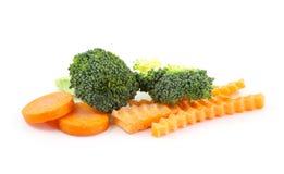 Bróculi y rebanada de zanahoria Imagen de archivo libre de regalías