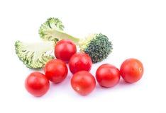 Bróculi y tomates Imagenes de archivo