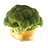 Bróculos com uma medidor-vara Fotografia de Stock Royalty Free