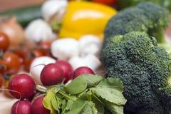 Bróculos e radishes Imagens de Stock
