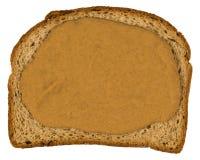 Bröd för helt vete för skiva, isolerat jordnötsmör Royaltyfri Bild