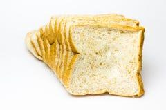 Bröd för helt vete på vit bakgrund royaltyfria foton
