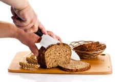 Bröd för manhandklipp på vit bakgrund Arkivbilder