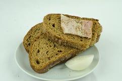 Bröd med löken och skinka Fotografering för Bildbyråer