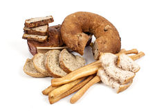 Bröd och breadsticks som isoleras på vit bakgrund Arkivfoton