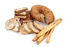 Bröd och breadsticks som isoleras på vit bakgrund Royaltyfri Fotografi