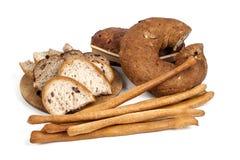 Bröd och breadsticks som isoleras på vit bakgrund Royaltyfria Foton