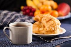 Bröd och kaffe Arkivfoto