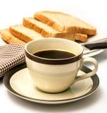 Bröd och kaffe indikerar mål Tid och svart royaltyfri fotografi