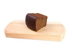 Bröd och skärbräda Arkivfoto