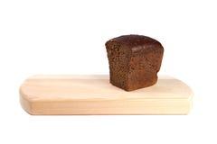 Bröd och skärbräda Arkivbild