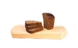 Bröd och skärbräda Royaltyfri Foto