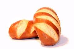 Bröd på en vit bakgrund Arkivfoto