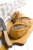 Bröd på skärbräda Fotografering för Bildbyråer