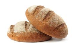 Bröd på vit Arkivbild