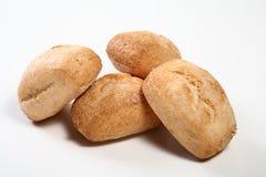 Bröd på vit bakgrund Arkivfoto