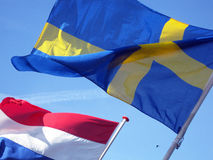 Bröder. Image of the flags of Sweden and the Netherlands Royalty Free Stock Photography