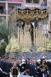 Brödraskap av Virgenen de la Esperanza i helig vecka arkivbilder