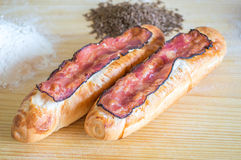 Brödrullar med bacon Royaltyfria Bilder