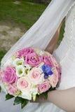 Bröllopbukett med rings.GN arkivbild