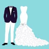 Bröllopkort med kläderna Arkivfoto