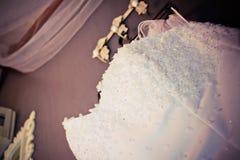 Bröllopsklänningdetaljer Arkivfoto