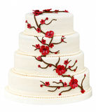 Bröllopstårta på vit bakgrund Arkivfoton