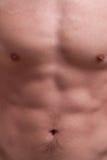 Bröstkorg och abdominals för barnmuskelman Fotografering för Bildbyråer