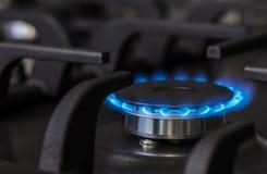 Brûleur brûlant à cuisinière à gaz de cuisine Images stock