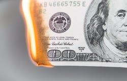 Brûlure de 100 USD Photographie stock libre de droits