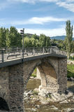 Brücke im riiver Segre Stockfotos