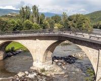 Brücke im riiver Segre Stockbilder