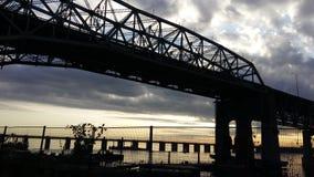 Brücke und Sonnenuntergang Stockfotos