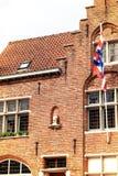 Brügge-Stadtsymbol, das Brugs Beertje auf der Fassade des Poort Lizenzfreies Stockbild