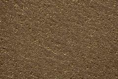 Brązowego koloru porowata szorstka powierzchnia, tekstury tło zdjęcia stock
